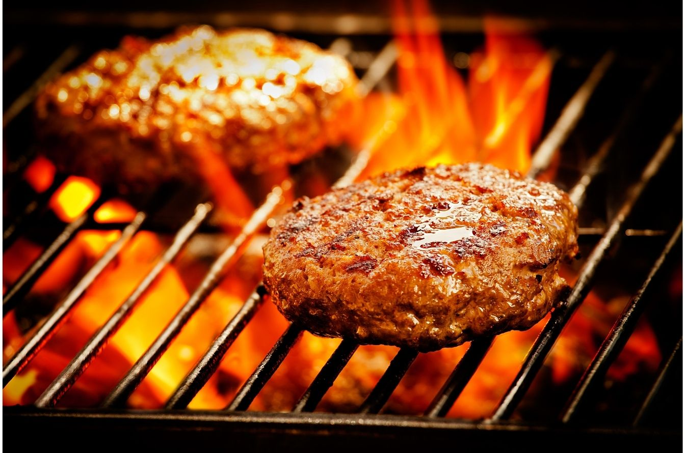 burger being cooked on grill